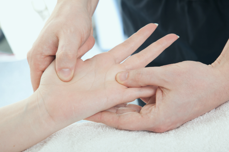 Hand surgeon assessing patient for thumb osteoarthritis